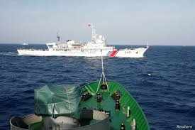 What needs to be done to reduce the risk of conflict in the South China Sea